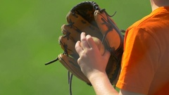 Close-up of a baseball glove and ball at little league baseball practice. Stock Footage