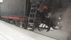 Old Retro Train arrives from the Railway Station. Close up detail of wheels Stock Footage