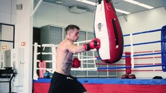 Boxer fulfills blows on the punching bag. Stock Footage