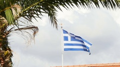 Flag of Greece, waving in slow motion against blue sky Stock Footage