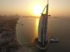 Aerial view of Burj Al Arab hotel in sunset scene, in Dubai, UAE. Stock Footage
