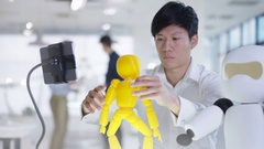4K Asian electronics engineer working in lab with robot prototype Stock Footage