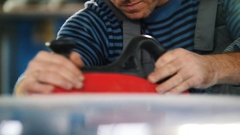 Automobile service - a worker polishes a blue car, close up Stock Footage