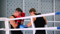 Man strikes in blue gloves. Stock Footage