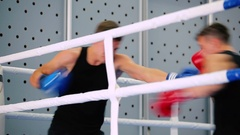 Opponents are boxing in the corner. Stock Footage