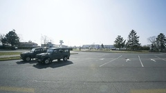 Two vigipirate military Land Rover jeep parked in the Entzheim Aeroport Stock Footage