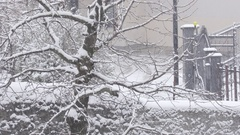 Thin and Windy Snowing on House Exterior - Winter Scene in Town Stock Footage