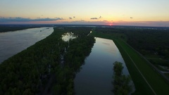 Swollen mississippi river with sunset sunrise on horizon aerial Stock Footage