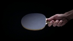 Hand holding table tennis racket and serve ping pong ball. Stock Footage