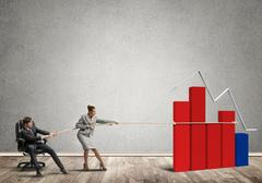 Businesspeople pulling with effort graph growth as a symbol of financial success Stock Photos