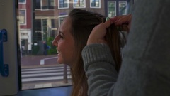 Closeup Of Happy Young Woman Smiling, As Friend Braids Her Hair On Moving Train Stock Footage