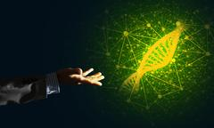 Science medicine and technology concepts as DNA molecule on dark background with Stock Photos