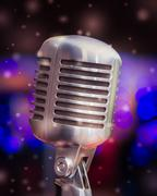 Microphone on a background of blue lights Stock Photos