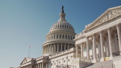Close up of DC Capitol Building with American Flag, clear blue skies, 4K Stock Footage