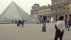 PARIS, FRANCE - DECEMBER, 31, 2016. Female tourists posing and making photos Stock Footage
