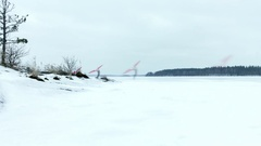 Time-lapse of ice sailing with a kitewing at a frozen lake Stock Footage