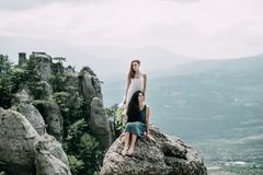 Women on rock overlooking landscape Kuvituskuvat