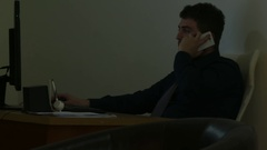Working and Talking on Smartphone in Dark Ambient Arkistovideo