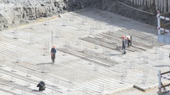 A team of builders working on the under construction building foundation Stock Footage
