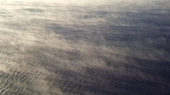Wispy Mists Over Rippling Water Diagonal Aerial HD Stock Footage