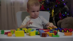 Footage little boy playing in the constructor Stock Footage