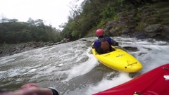 A man kayaks down a waterfall on a river, slow motion. Stock Footage