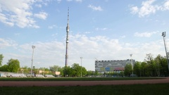 Standalone television and ratio tower, Ostankino in Moscow, large sport field Stock Footage