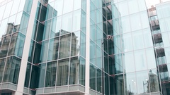 Distorted reflection of old building in modern glass facade of office center in Stock Footage