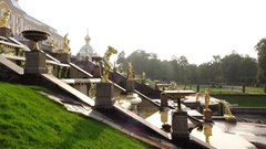 Slide shot of Grand Cascade in Peterhof royal park, sunny evening time Stock Footage