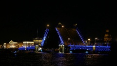 Famous bascule bridge finish opening at night time, two leafs slowly rise Stock Footage
