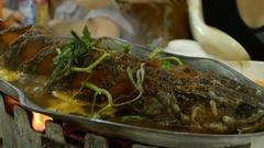 Snake head fish fried. Thai food salad. Stock Footage