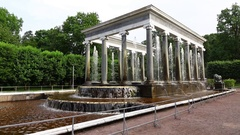 Slow water jets rush between columns of majestic fountain colonnade Stock Footage