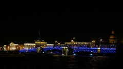 Palace Bridge at night time, touristic boats gather to watch nightly show Stock Footage