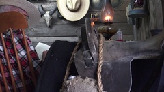 Cowboy Western rocking in chair, anonymous man reading book Stock Footage