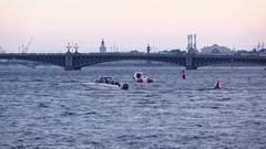 Motor boats sail at open water of Neva river, evening time, telephoto view Stock Footage