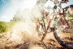 Mountain Biker Riding Through A Dirty Puddle Stock Photos