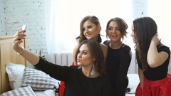 Young women having fun and photographing selfie on smartphone at home party Stock Footage