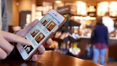 Motion of woman browsing Starbucks drink menu on phone Stock Footage