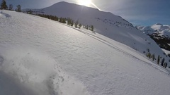 A young man snowboarding fresh power snow through trees in the mountains, super Stock Footage