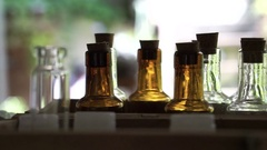 Homemade craft essence perfume or oil fragrant container bottles in rows Stock Footage