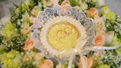 Wedding rings on a bouquet Stock Footage