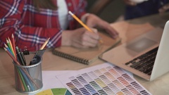 Young design students working on decoration project, choosing colors, brainstorm Stock Footage