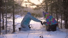 Slow Motion Two Adult Women Playing With the Dog in the Snow. Sunny Winter Day Stock Footage