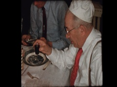 Grandfather recites prayer over wine for Passover Sedar Stock Footage