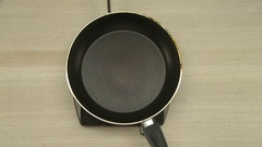Cooker putting vegetable oil on hot frying pan Stock Footage