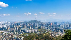 Time lapse of Cityscape in Seoul with Seoul tower and blue sky. Stock Footage