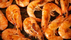 Spanish prawns frying in olive oil on the grill pan Stock Footage