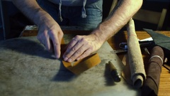 Working process of making leather belt in the leather workshop Stock Footage