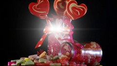 Valentine candy rotating against lens flare Stock Footage