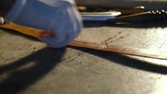Leather handbag craftsman at work in a workshop Stock Footage